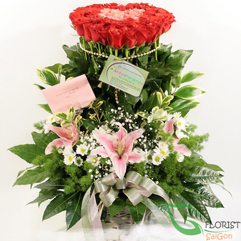 Basket of red roses and lilies