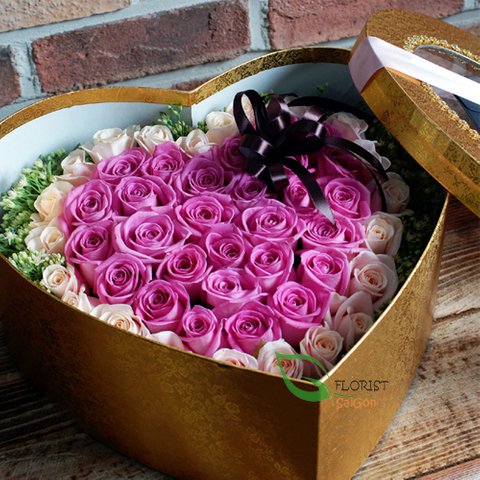 Box of purple roses