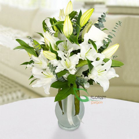 Saigon flowers in a vase with white lilies