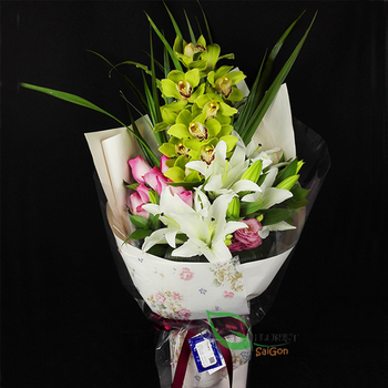A flower bouquet with orchid and lilies