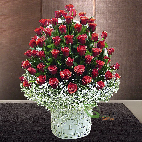 99 red roses arranged with baby flowers